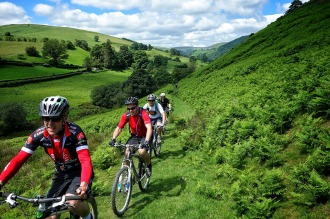 Another group of happy mountain bikers riders doing the Wayfarer